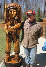 Flushing, Ohio, chainsaw artist, Ed, with recent sculpture.
