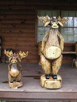 Two mooses created by Flushing, Ohio, chainsaw artist Ed.