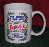 Coffee cup with Stratton's Self-Rising Whole Wheat Pancake Flour sack design.